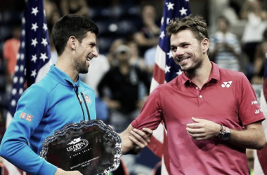 Stan Wawrinka (right) and Novak Djokovic share a laugh during the US Open trophy presentation. Photo: AFP