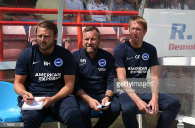 Graham Potter manager of Brighton and Hove Albion with Assistant head coach Billy Reid and First team coach Bjorn Hamberg during the Pre-Season Friendly match between Brighton and Hove Albion and Fulham. Image courtesy of Marc Atkins on Getty Images.
