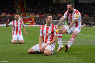 Goalscorer Nick Powell of Stoke City celebrates with Tommy Smith and Steven Fletcher during the Sky Bet Championship match between Stoke City and West Bromwich Albion at Bet365 Stadium on October 01, 2021 in Stoke on Trent, England. (Photo by Malcolm Couzens/Getty Images)