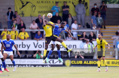 BURTON-UPON-TRENT, ENGLAND - JULY 24: Wilfred Ndidi of Leicester City in action with Lucas Akins of Burton Albion during the Pre-Season friendly between Burton Albion and Leicester City at Pirelli Stadium on July 24, 2021 in Burton-upon-Trent, England. (Photo by Plumb Images/Leicester City FC via Getty Images)