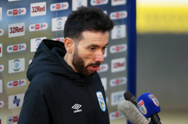 <div>Preston North End v Huddersfield Town - Sky Bet Championship</div><div>PRESTON, ENGLAND - FEBRUARY 27: Carlos Corberan, Manager of Huddersfield Town, is interviewed after the Sky Bet Championship match between Preston North End and Huddersfield Town at Deepdale on February 27, 2021 in Preston, England. Sporting stadiums around the UK remain under strict restrictions due to the Coronavirus Pandemic as Government social distancing laws prohibit fans inside venues resulting in games being played behind closed doors. (Photo by Charlotte Tattersall/Getty Images)</div>