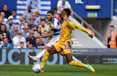 Nahki Wells of Queens Park Rangers and Cheyenne Dunkley of Wigan Athletic during the Sky Bet Championship match between Queens Park Rangers and Wigan Athletic at Loftus Road on August 25, 2018 in London, England. (Photo by Henry Browne/Getty Images)