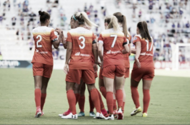 Daly(Number 3) celebrates a goal with her Dash teammates//Source:IconSportwire