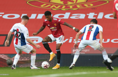 MANCHESTER, ENGLAND - SEPTEMBER 19: Marcus Rashford of Manchester United in action with James McCarthy and Joel Ward of Crystal Palace during the Premier League match between Manchester United and Crystal Palace at Old Trafford on September 19, 2020 in Manchester, England. (Photo by Matthew Peters/Manchester United via Getty Images)