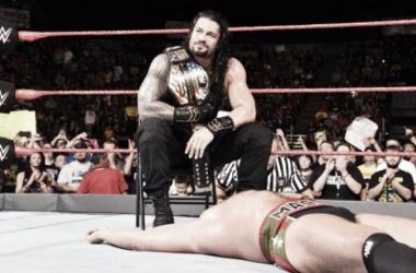 Roman Reigns sits above the fallen Rusev (image: sporteskeeda.com)