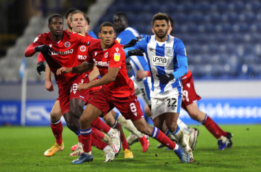 (l - r) Lucas Joao, Michael Morrison and Andy Rinomhota of Reading battle for possession with Fraizer Campbell of Huddersfield Town from a cross during the Sky Bet Championship match between Huddersfield Town and Reading at John Smith's Stadium on January 02, 2021 in Huddersfield, England. (Photo by Huddersfield FC/Getty Images)