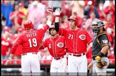 Joey Votto celebrates his two-run shot with teammates.