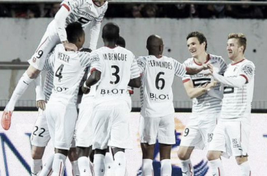 Rennes players celebrate 2nd goal.