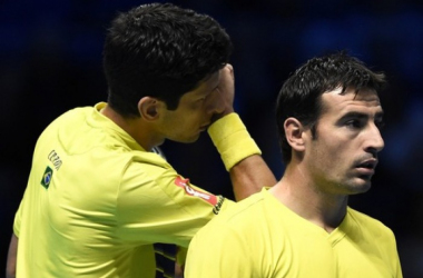 Marcelo Melo (left) and Ivan Dodig were upset in third round action/Photo: Reuters