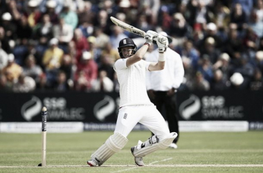 Root scores ton on absorbing first day in Cardiff