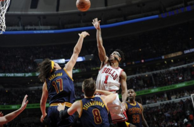 Derrick Rose sky's for a floater over Anderson Varejao and Matthew DellavedovaBill Smith/Chicago Bulls