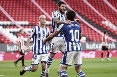 Portu, Oyarzabal y Guridi celebran el gol frente al Athletic Club // Foto: Real Sociedad