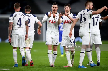 LONDON, ENGLAND - FEBRUARY 24: Gareth Bale of Tottenham Hotspur celebrates with team mate Ben Davies after scoring their side's third goal during the UEFA Europa League Round of 32 match between Tottenham Hotspur and Wolfsberger AC at The Tottenham Hotspur Stadium on February 24, 2021 in London, England. Sporting stadiums around the UK remain under strict restrictions due to the Coronavirus Pandemic as Government social distancing laws prohibit fans inside venues resulting in games being played behind closed doors. (Photo by Julian Finney/Getty Images)