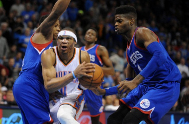 Russell Westbrook of the Oklahoma City Thunder splits the double team by Isaiah Canaan and Nerlens Noel of the Philadelphia 76ers. (Mark D. Smith - USA TODAY Sports)