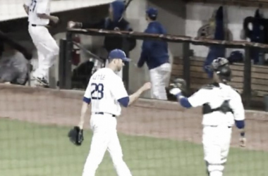 Connor Little celebrates with his catcher coming off the field in the eighth inning. (Screenshot captured via americanassociationbaseball.tv)