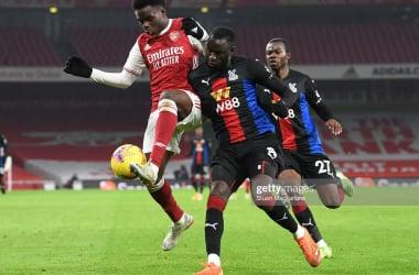 Bukayo Saka battles against Cheikhou Kouyaté and Tyrick Mitchell in this same fixture last season |Photo by Stuart MacFarlane/Arsenal FC via Getty Images
