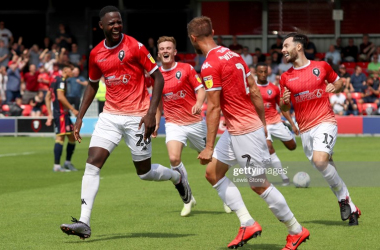 Leeds-born Emmauel Dieseruvwe celebrates one of his two goals for Salford on the opening day of the season. | Photo by Lewis Storey/Getty Images.
