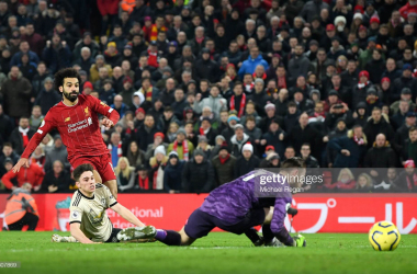 LIVERPOOL, ENGLAND - JANUARY 19: Mohamed Salah scores the 2nd goal during the Premier League match between Liverpool FC and Manchester United at Anfield on January 19, 2020 in Liverpool, United Kingdom. (Photo by Michael Regan/Getty Images)