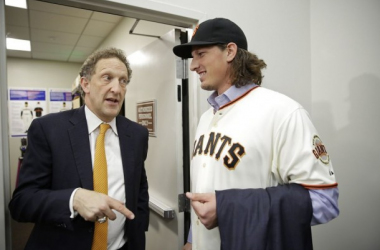 Jeff Samardzija is all smiles after signing a five year contract worth $90 million with the San Francisco Giants on December 9. He is pictured with team CEO Larry Baer. (Photo: AP/Eric Risberg)