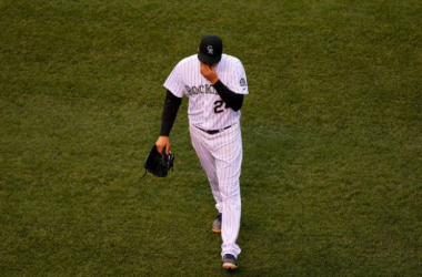 Starting pitcher Jordan Lyles #24 of the Colorado Rockies walks off the field after being removed from the game after giving up six earned runs in just three and one third innings against the San Diego Padres at Coors Field on May 17, 2014 in Denver, Colo