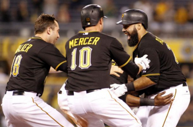 Pedro Alvarez #24 of the Pittsburgh Pirates celebrates his walk off single with teammates in the ninth inning against the San Diego Padres during the game at PNC Park on July 6, 2015 in Pittsburgh, Pennsylvania. (July 5, 2015 - Source: Justin K. Alle