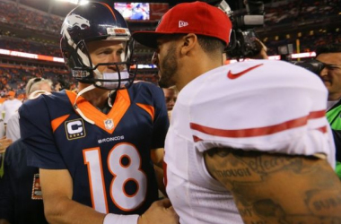 Quarterback Peyton Manning #18 of the Denver Broncos and quarterback Colin Kaepernick #7 of the San Francisco 49ers shake hands after a game at Sports Authority Field at Mile High on October 19, 2014 in Denver, Colorado.(Oct. 18, 2014 - Source: