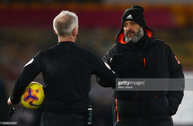 WOLVERHAMPTON, ENGLAND - JANUARY 12: Nuno Espirito Santo, Manager of Wolverhampton Wanderers shakes hands with referee Martin Atkinson following the Premier League match between Wolverhampton Wanderers and Everton at Molineux on January 12, 2021 in Wolverhampton, England. Sporting stadiums around England remain under strict restrictions due to the Coronavirus Pandemic as Government social distancing laws prohibit fans inside venues resulting in games being played behind closed doors. (Photo by Marc Atkins/Getty Images)