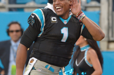 Cam Newton #1 of the Carolina Panthers listens to the fans cheer during the final seconds of a win against the Atlanta Falcons at Bank of America Stadium on December 13, 2015 in Charlotte, North Carolina. The Panthers won 38-0. (Photo by Grant Halver