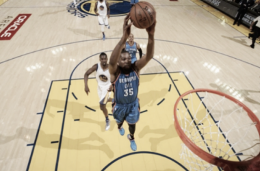Kevin Durant dunks for two of his 26 points during Thunder-Warriors Game One. (Photo Credit: Noah Graham, NBAE)