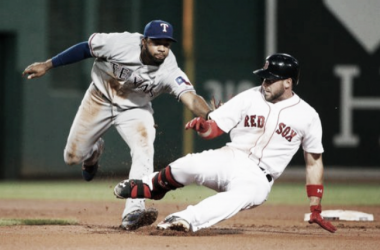 Red Sox first baseman Travis Shaw is tagged out in the fourth inning attempting to extend a single to extra bases. | Photo: Associated Press