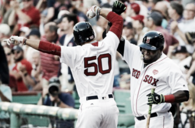 Mookie Betts celebrates his first-inning homer with David Ortiz. | AP Photo - Elise Amendola