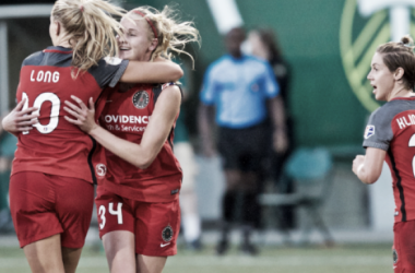 Allie Long and Tyler Lussi celebrate the Thorns' equalizer | Source: Sam Ortega - ISI Photos