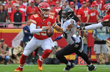 Patrick Mahomes escapes from a tackle against the Baltimore Ravens (Photo: Peter Aiken)