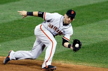Scutaro fields a line drive in Game 5 of the 2012 NLCS. (AP)