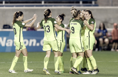 Seattle players celebrate Katie Johnson's game-winning goal | Photo: Seattle Reign FC - thebold.net