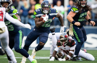 Chris Carson looks to run the ball up the field. Minnesota battles Seattle at CenturyLink Field on Monday Night Football. (Andy Bao/ The Seattle Times)
