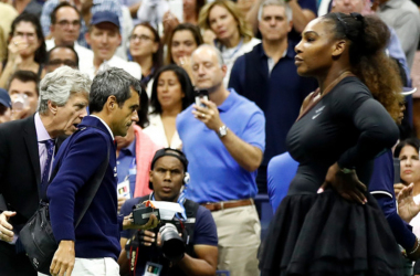 "Serena Williams looks on as chair umpire Carlos Ramos is escorted off the court by U.S. Open tournament referee Brian Earley. | Photo: <span style=""color: rgb(153, 153, 153); font-family: helvetica, arial, verdana, sans-serif; font-style: normal; text-align: start; background-color: rgb(255, 255, 255);"">Julian Finney/Getty Images</span>"