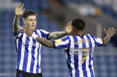 Sheffield Wednesday's Josh Windass celebrates his winning goal with provider Kadeem Harris. Photo: Alex Pantling/Getty Images.