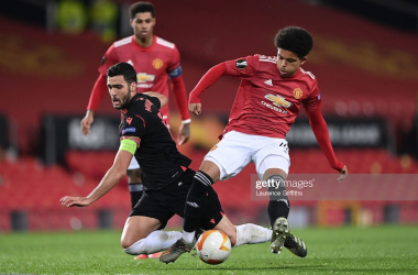 <div>MANCHESTER, ENGLAND - FEBRUARY 25: Mikel Merino of Real Sociedad is tackled by Shola Shoretire of Manchester United during the UEFA Europa League Round of 32 match between Manchester United and Real Sociedad at Old Trafford on February 25, 2021 in Manchester, England. (Photo by Laurence Griffiths/Getty Images)</div>