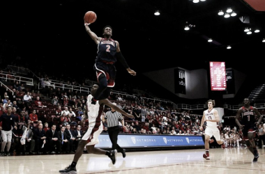 Kobi Simmons puts emphatic finish on victory over Stanford Cardinal. | Photo: Mike Christy / AZ Daily Star