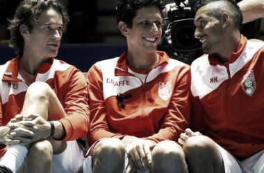 From left to right, Carlos Moya, Marcelo Melo, and Nick Kyrgios chat on the Singapore Slammers bench. Photo: IPTL