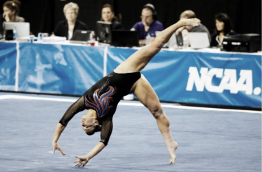 Bridget Sloan performs a tumbling pass on floor exercise at the NCAA Women's Gymnastics Championships/Photo courtesy: AP/Tony Guttierez