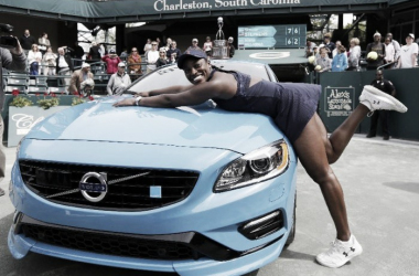 Sloane Stephens poses with her brand new Volvo P60 Polestar and trophy (top) after being crowned 2016 Volvo Car Open champion. Photo credit: Mic Smith/Associated Press.