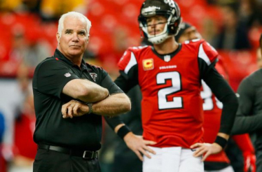 Sacked head coach Mike Smith (left) with quarterback Matt Ryan (right)