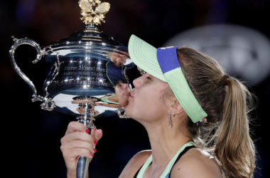 Sofia Kenin kisses the Australian Open trophy after claiming her first grand slam title.&nbsp;<div>(AP Photo/Lee Jin-Man).</div>