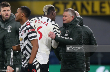 Manchester United Head Coach / Manager Ole Gunnar Solskjaer reacts to Paul Pogba of Manchester United at the end of the Premier League match between Burnley and Manchester United at Turf Moor on January 12, 2021 in Burnley, United Kingdom. Sporting stadiums around England remain under strict restrictions due to the Coronavirus Pandemic as Government social distancing laws prohibit fans inside venues resulting in games being played behind closed doors. (Photo by Matthew Peters/Manchester United via Getty Images)