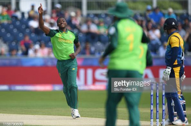 Kagiso Rabada celebrates taking the wicket of Dimuth Karunaratne during the Group Stage match of the ICC Cricket World Cup 2019 between Sri Lanka and South Africa. Image courtesy of Stu Forster from IDI/IDI on Getty Images.