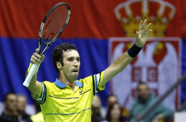 Mikhail Kukushkin raises his arms in victory/Photo: Srdjan Stevanovic