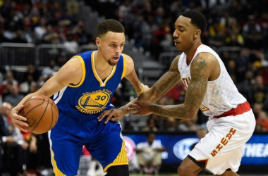 Jeff Teague defending Steph Curry. Dale Zanine/USA TODAY Sports