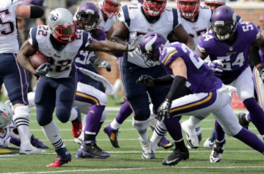 Stevan Ridley's 101 yards and touchdown run helped lead the Patriots over the Vikings (Jim Mone / AP Photo)